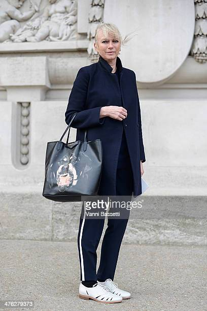 Harvey Nichols' Tina Lamb wears Vince trousers and coat Givenchy Bag and Clark's shoes before Chloe show at the Grand Palais on March 2 2014 in Paris...
