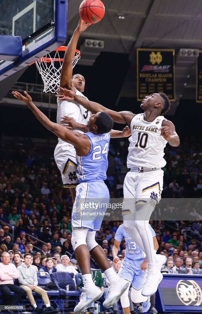 D.J. Harvey #3 of the Notre Dame Fighting Irish goes up high to block the shot of Kenny Williams #24 of the North Carolina Tar Heels at Purcell Pavilion on January 13, 2018 in South Bend, Indiana.
