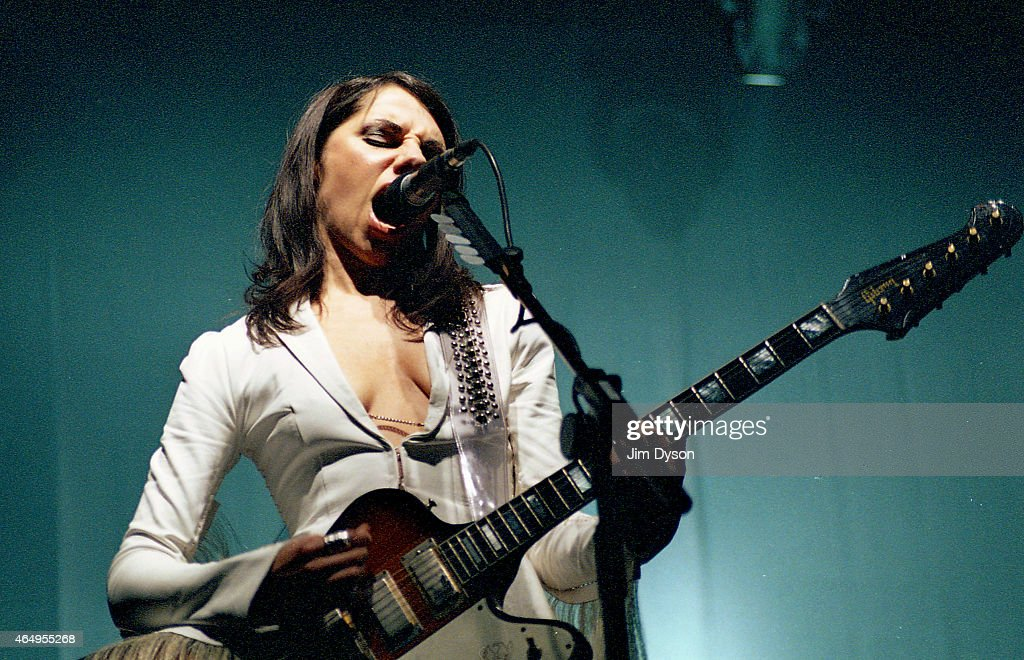 PJ Harvey performs live on stage at Tate Modern on September 1, 2003 in London, United Kingdom.