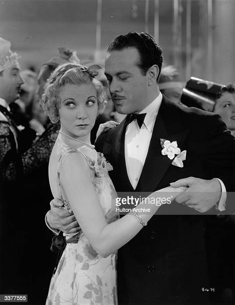 Harvey Stephens and Una Merkel dancing at a Christmas party in a scene from the MGM crime caper 'Baby Face Harrington' directed by Raoul Walsh