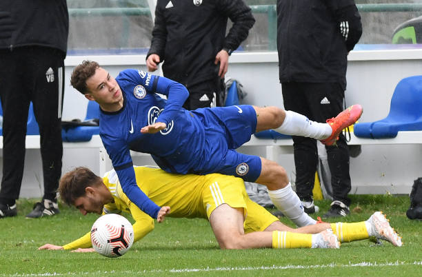Harvey Vale of Chelsea takes a tumble during the U18 Premier League match between Chelsea and Fulham at Chelsea Training Ground on May 15, 2021 in...