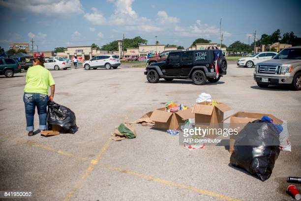 Harvey victims gather donated supplies outside Center Mall in Port Arthur Texas on September 2 2017 As floodwaters receded in Houston nearby cities...