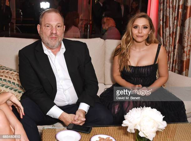 Harvey Weinstein and Elizabeth Olsen attend The 9th Annual Filmmakers Dinner hosted by Charles Finch and JaegerLeCoultre at Hotel du CapEdenRoc on...