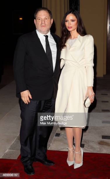 Harvey Weinstein and Georgina Chapman attend a Dramatic Arts reception hosted by Queen Elizabeth II at Buckingham Palace on February 17 2014 in...