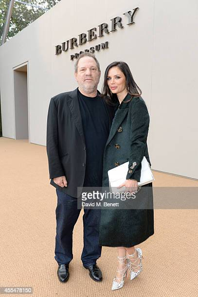 Harvey Weinstein and Georgina Chapman attend the Burberry Womenswear SS15 show during London Fashion week at Kensington Gardens on September 15 2014...