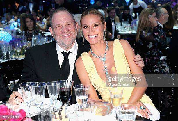 Harvey Weinstein and Heidi Klum attend the amfAR's 23rd Cinema Against AIDS Gala at Hotel du CapEdenRoc on May 19 2016 in Cap d'Antibes France