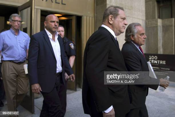 Harvey Weinstein and his lawyer Ben Brafman exit Manhattan Criminal Court on July 9 2018 in New York for arraignment on charges alleging he committed...