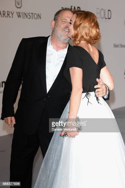 Harvey Weinstein and Lindsay Lohan arrive at the amfAR Gala Cannes 2017 at Hotel du CapEdenRoc on May 25 2017 in Cap d'Antibes France