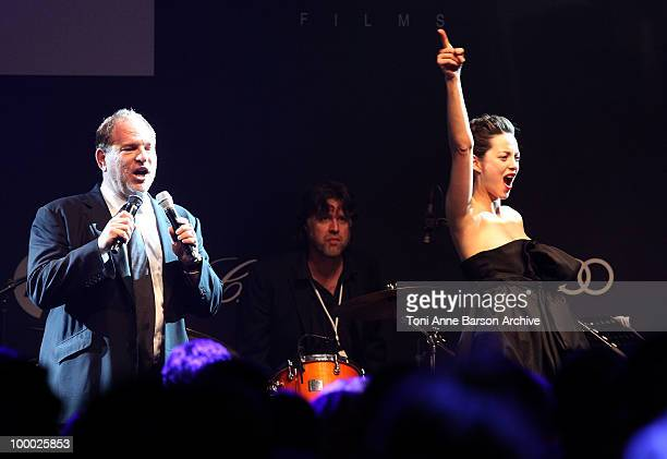 Harvey Weinstein and Marion Cotillard speak during amfAR's Cinema Against AIDS 2010 benefit gala at the Hotel du Cap on May 20 2010 in Antibes France