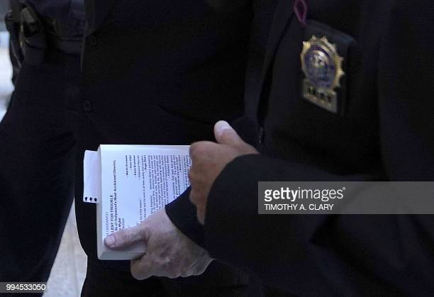 Harvey Weinstein arrives carrying a book at Manhattan Criminal Court July 9 2018 in New York for arraignment on charges alleging he committed a sex...
