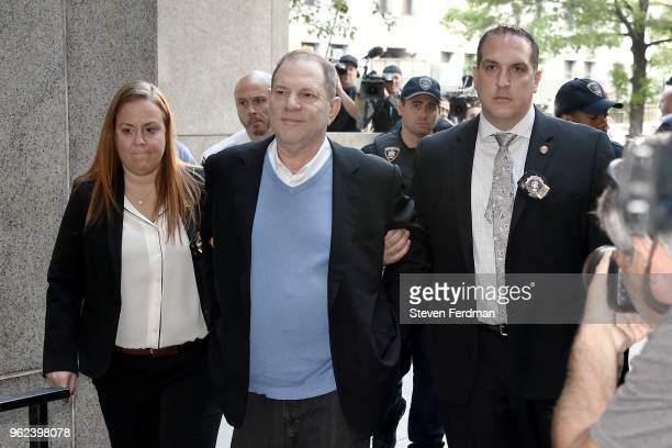 Harvey Weinstein arrives for arraignment at Manhattan Criminal Courthouse in handcuffs after being arrested and processed on charges of rape,...