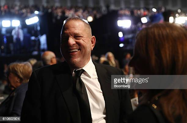 Harvey Weinstein cochairman and cofounder of Weinstein Co speaks with an attendee in the audience ahead of the first US presidential debate at...