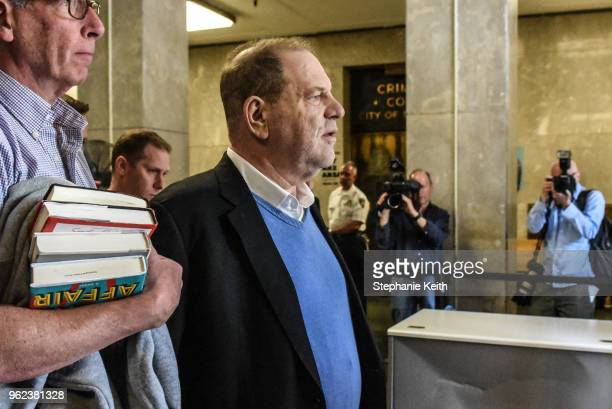 Harvey Weinstein exits the court room after his arraignment at Manhattan Criminal Court on May 25 2018 in New York City The former movie producer...