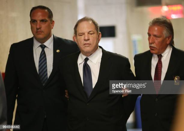 Harvey Weinstein is escorted in handcuffs into State Supreme Court on Monday for arraignment on charges alleging he committed a sex crime against a...