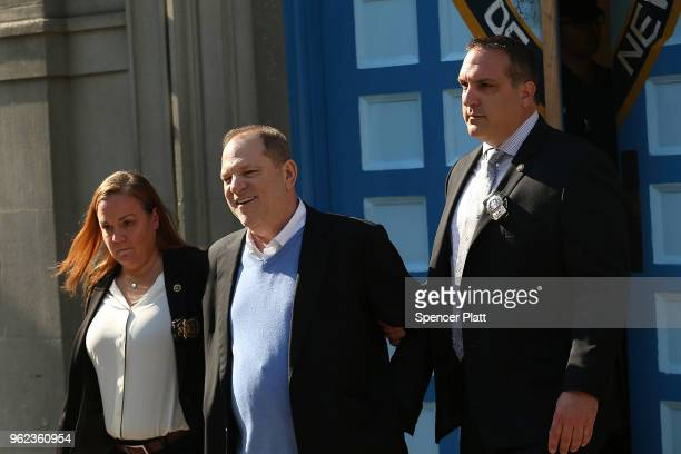 Harvey Weinstein is led out of the New York Police Department's First Precinct in handcuffs after being arrested and processed on charges of rape...