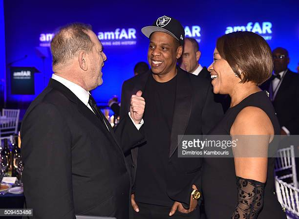 Harvey Weinstein Jay Z and Grace Hightower attend the 2016 amfAR New York Gala at Cipriani Wall Street on February 10 2016 in New York City