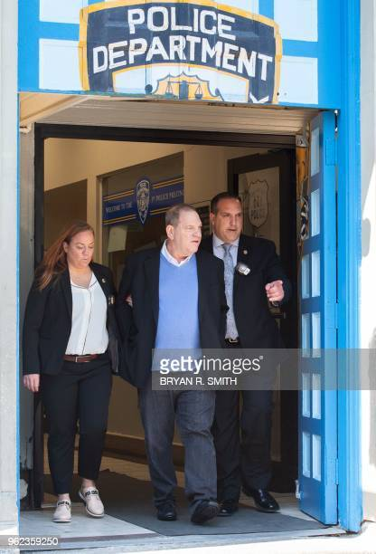 TOPSHOT Harvey Weinstein leaves the New York City Police Department's First Precinct on May 25 2018 in New York Weinstein was arrested and charged...