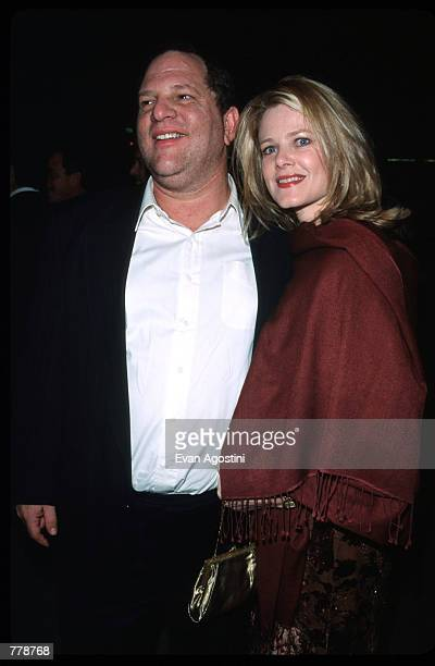 Harvey Weinstein poses for a photograph with with his wife Eve Chilton Weinstein October 26 1999 at the premiere of ''Music of the Heart'' in New...