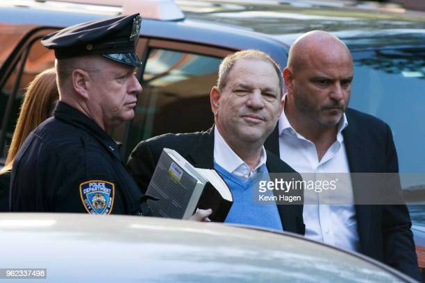 Harvey Weinstein turns himself in to the New York Police Department's First Precinct after be served with criminal charges by the Manhattan District...