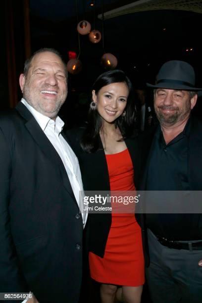 Harvey Weinstein Ziyi Zhang and James Dolan attend The New York Premiere of THE GRANDMASTER at Regal EWalk Stadium 13 on August 13 2013 in New York...
