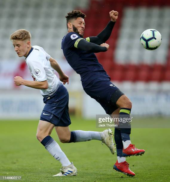 Harvey White of Tottenham Hotspur challenges for the ball with Kellan Gordon of Derby County during the Premier League 2 match between Tottenham...