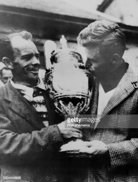 Harvie Ward kisses the cup at the British Amateur Golf Championship in 1952 'n