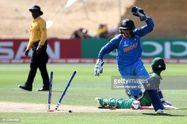 Harvik Desai of India celebrates the run out of Aminul Islam Biplob of Bangladesh during the ICC U19 Cricket World Cup match between India and...