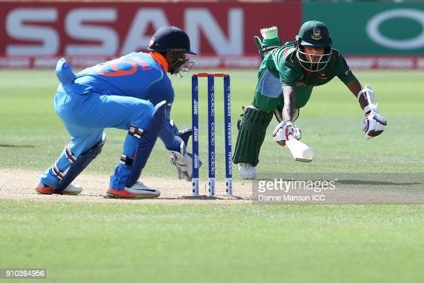 Harvik Desai of India runs out Aminul Islam Biplob of Bangladesh during the ICC U19 Cricket World Cup match between India and Bangladesh at John...