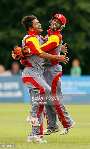 Harvir Baidwan of Canada celebrates with team mate and wicket keeper J. Smits after bowling out Ryan Ten Doeschate of the Netherlands during the...