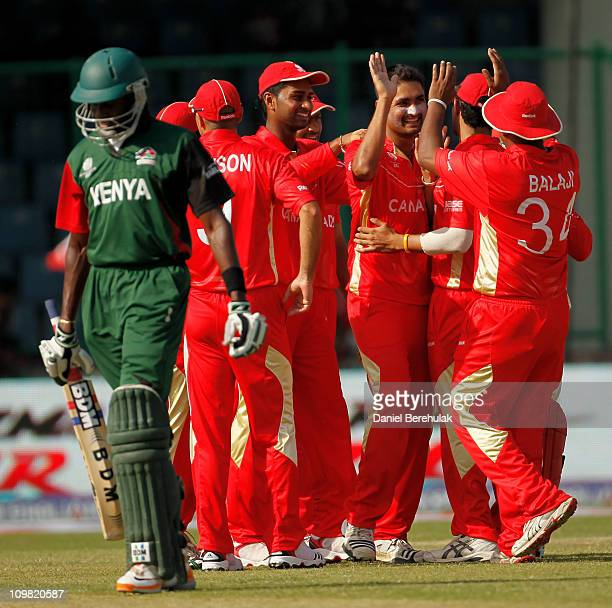 Harvir Baidwan of Canada celebrates with teammates after taking the wicket of Collins Obuya of Kenya during the ICC Cricket World Cup group A match...