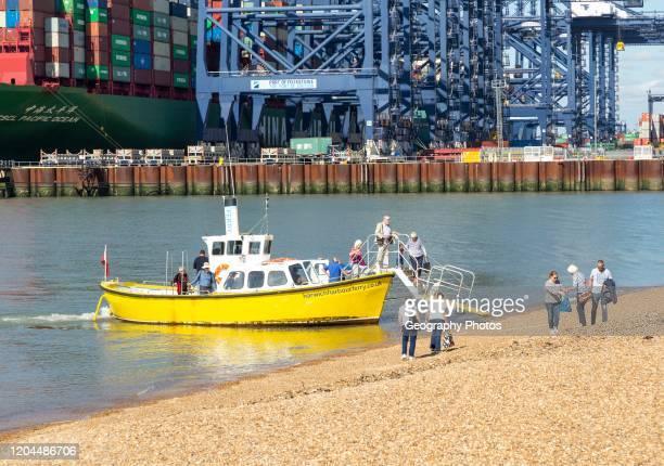 Harwich harbor foot ferry landing passengers at beach, Port of Felixstowe, Suffolk, England, UK.