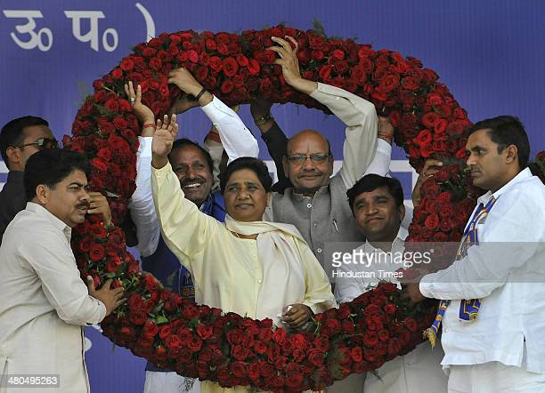 Haryana BSP leaders welcome Bahujan Samaj Party chief Mayawati during an election campaign rally at Leisure Valley on March 25 2014 in Gurgaon India