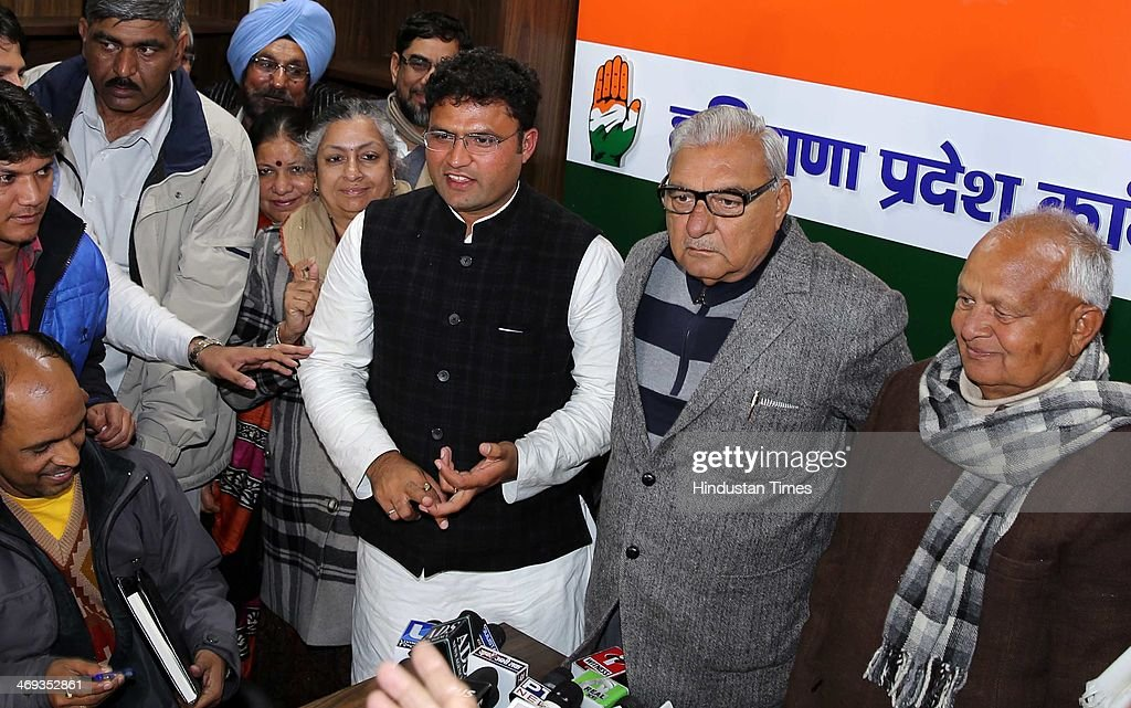 Haryana Chief Minister Bhupinder Singh Hooda Phool Chand Mullana former HPCC president with Ashok Tanwar after he was elected as the Haryana Pradesh..
