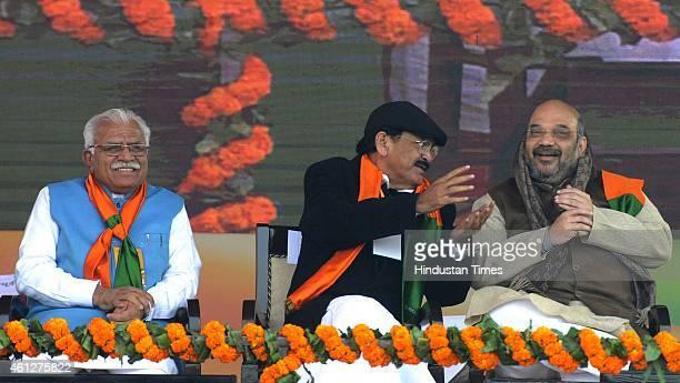 Haryana Chief Minister Manohar Khattar Minister of Urban Development Venkaiah Naidu talking with national BJP President Amit Shah during the...