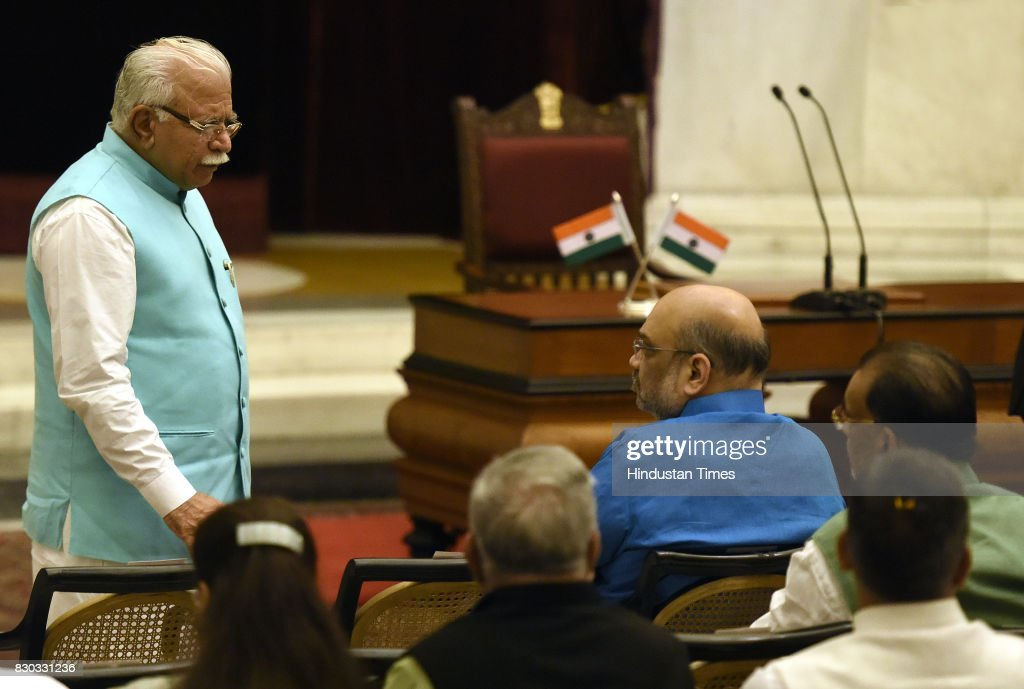 Haryana Chief Minister Manohar Lal Khattar talking with BJP National President and Newly Rajya Sabha MP Amit Shah during the 13th VicePresident of...