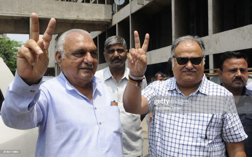 Haryana Congress senior leader Bhupinder Singh Hooda and Kuldeep Sharma during the presidential election at Haryana Vidhan Sabha on July 17 2017 in...