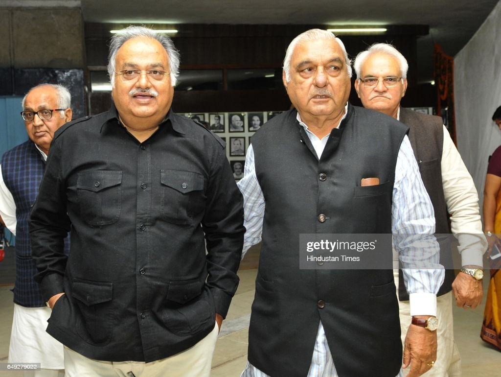 Haryana congress senior leader Kuldeep Sharma and Bhupinder Singh Hooda at Haryana Vidhan Sabha on March 7 2017 in Chandigarh India