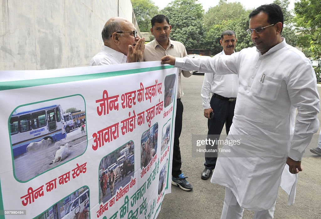 Haryana Finance Minister Captain Abhimanyu interacts with Hari Chand Middha outside at Haryana Vidhan Sabha on August 30 2016 in Chandigarh India