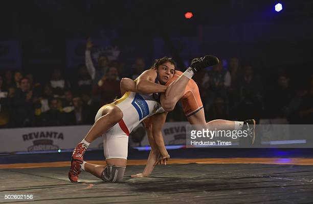 Haryana Hammers wrestler Oksana Herhel in action against Sakshi Malik of Mumbai Garuda during the Pro Wrestling League final match at the KD Jadhav...