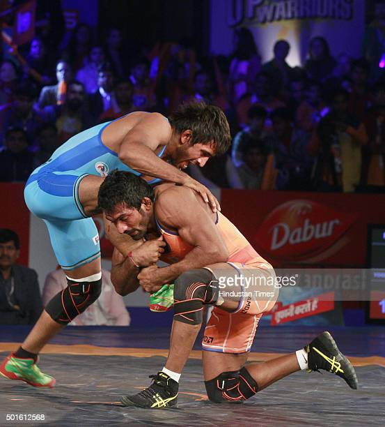 Haryana Hammers wrestler Yogeshwar Dutt in action against Bajrang Punia of Bengaluru Yodhas during the Pro Wrestling League match between Haryana...