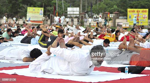 Haryana Health Minister Anil Vij participating in Yoga camp conducted by Yoga guru Ramdev at Parade Ground in Sector 5 on June 13 2016 in Panchkula...