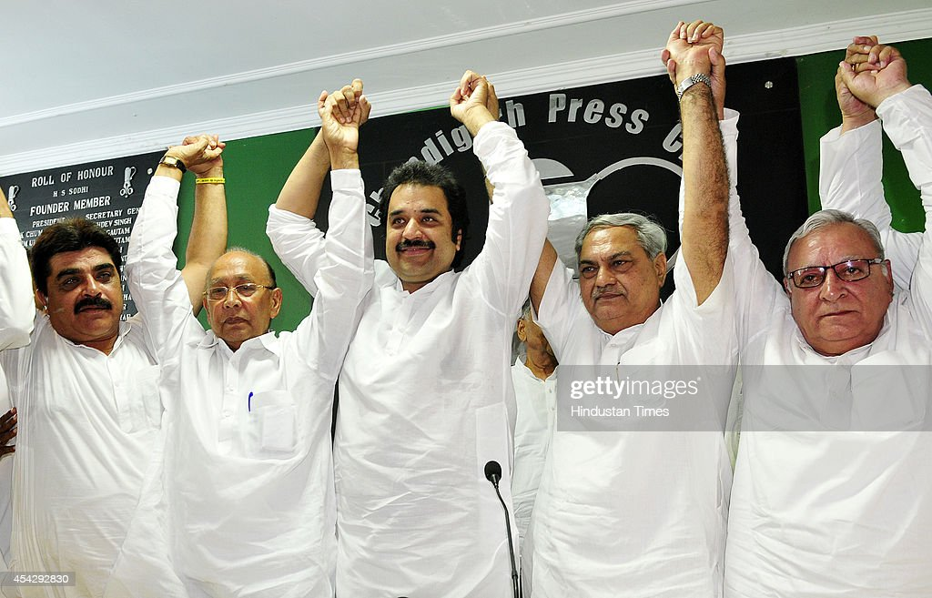 Haryana Janhit Congress president Kuldeep Bishnoi and Jan Chetna Party president Venod Sharma with other leaders raise hands as they announce their...