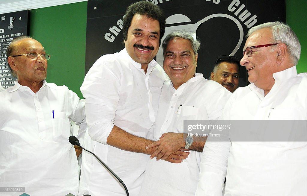 Haryana Janhit Congress president Kuldeep Bishnoi hugs Jan Chetna Party president Venod Sharma as they announce their alliance on August 28 2014 in...