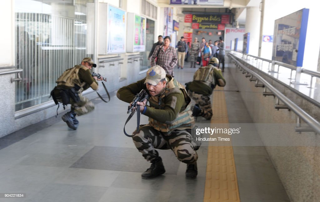 Haryana Police personnel and Central Industrial Security Force (CISF) in action during the joint mock drill at MG road metro station ahead of Republic Day on January 12, 2018 in Gurgaon, India.