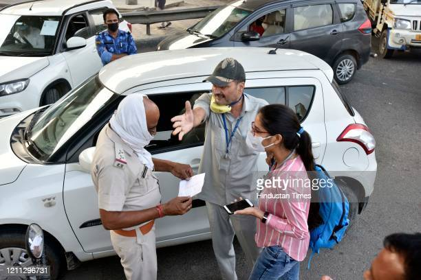 Haryana Police personnel screen vehicles for identity cards and permits at Delhi-Faridabad border after it was sealed, during lockdown, at NH 19 on...