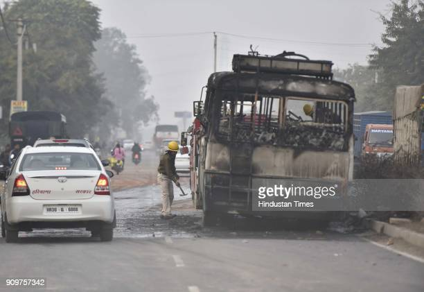 Haryana Roadways bus that was set on fire today near village Bhondsi allegedly by activists of Karni Sena who were protesting against the release of...