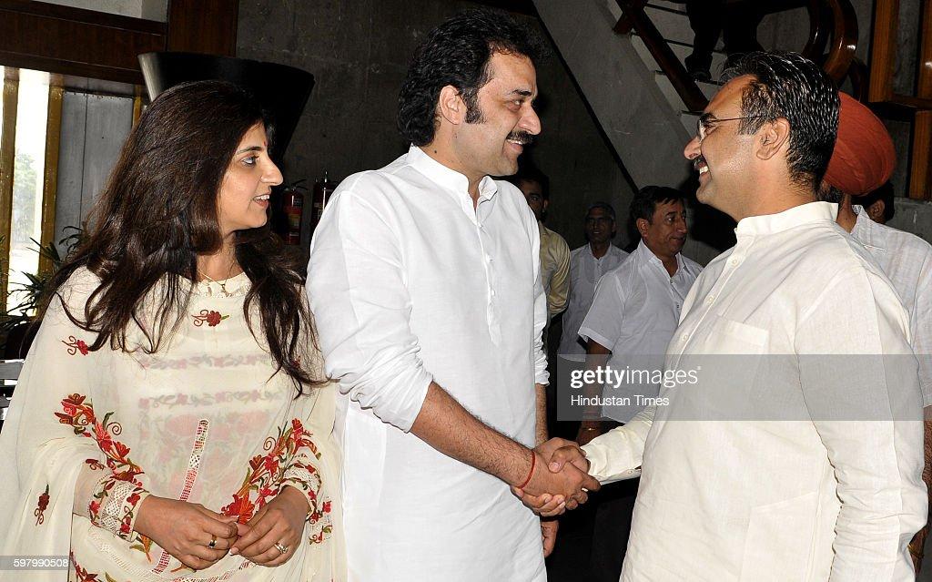 Haryana senior Congress leaders Kuldeep Bishnoi and wife Renuka Bishnoi interact with BJP leader Harvinder Kalyan at Haryana Vidhan Sabha on August...