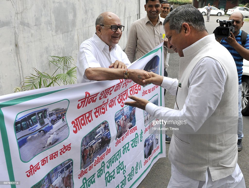Haryana Speaker Kanwar Pal Gujjar interacts with Hari Chand Middha outside at Haryana Vidhan Sabha on August 30 2016 in Chandigarh India