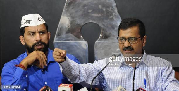 S Haryana Unit President Naveen Jaihind and Delhi CM Arvind Kejriwal during a press conference at Chandigarh Press Club on November 1 2018 in...