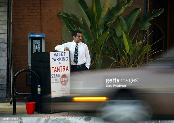 MORALES has been a parking attendant for 5–6 years and is employed by 21st Century Valet Parking Services He is photographed as a car passes as he...